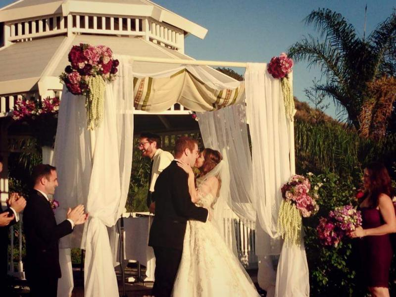 Ceremony Arch, Chuppah with fabric, florals and purple mixed flowers, hydrangea