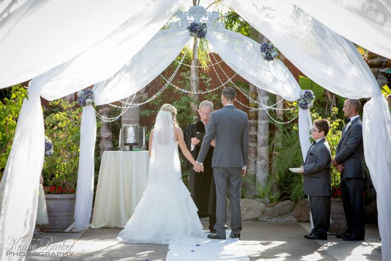 Ceremony Arch with fabric, florals and crystals